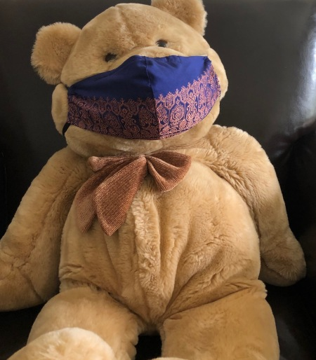 A teddy bear wearing a mask.